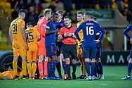 Arnaud Djoum (#10) of Heart of Midlothian and his team mates surround referee Nick Walsh after he gives Livingston a penalty and during the Ladbrokes Scottish Premiership match between Livingston FC and Heart of Midlothian FC at the Tony Macaroni Arena, Livingston, Scotland on 14 December 2018.
