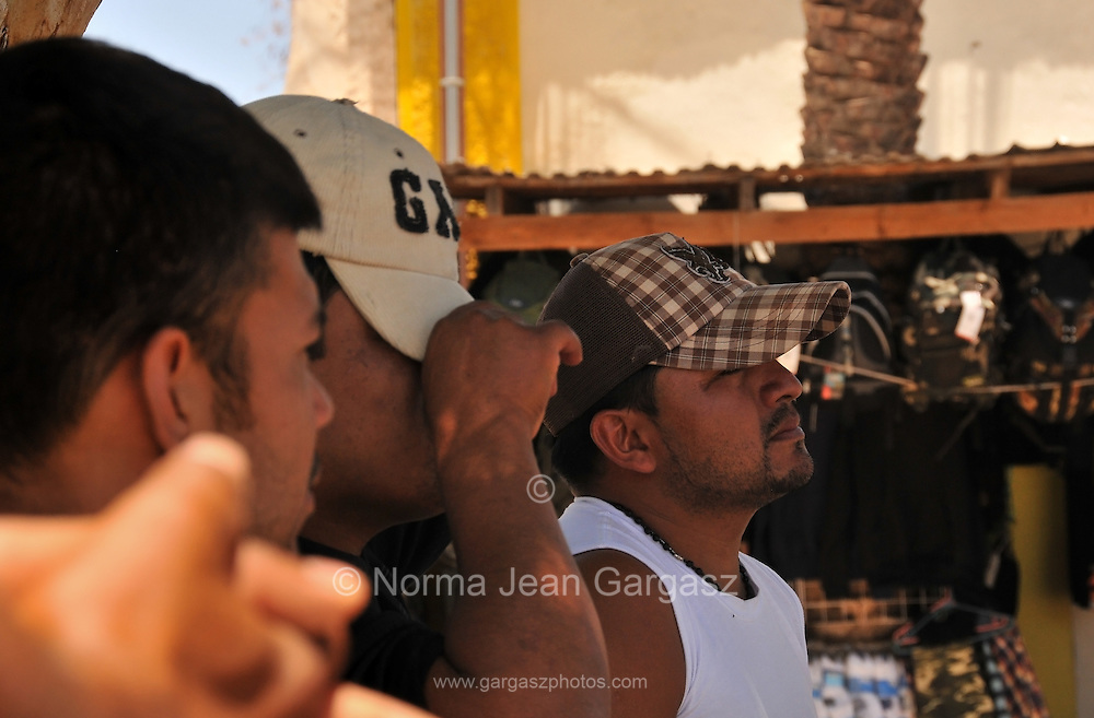 Men in Altar, Sonora, Mexico wait at the plaza before being transported to the U.S. and Mexico border at Arizona, where migrants enter the United States illegally.