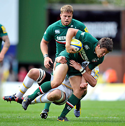 Leicester Tigers centre Anthony Allen is tackled in possession - Photo mandatory by-line: Patrick Khachfe/JMP - Tel: Mobile: 07966 386802 - 08/09/2013 - SPORT - RUGBY UNION - Welford Road Stadium - Leicester Tigers v Worcester Warriors - Aviva Premiership.