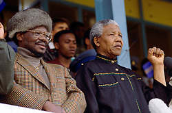 NELSON ROLIHLAHLA MANDELA (July 18, 1918 - December 5, 2013), 95, world renown civil rights activist and world leader. Mandela emerged from prison to become the first black President of South Africa in 1994. As a symbol of peacemaking, he won the 1993 Nobel Peace Prize. Joined his countries anti-apartheid movement in his 20s and then the ANC (African National Congress) in 1942. For next 20 years, he directed a campaign of peaceful, non-violent defiance against the South African government and its racist policies and for his efforts was incarcerated for 27 years. Remained strong and faithful to his cause, thru out his life, of a world of peace. Transforming the world, to make it a better place. PICTURED: 1994 - Soweto, South Africa - NELSON MANDELA and IFP leader Chief MANGOSUTHU BUTHELEZI, address a joint rally of their supporters at Orlando Stadium.  (Credit Image: © Greg Marinovich/ZUMA Wire/ZUMAPRESS.com)