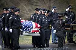 April 4, 2017 - Louisville, Kentucky, U.S. - Fellow officers carry the casket of Louisville Metro Police Officer Nick Rodman to his gravesite in Louisville, Kentucky, Tuesday April 4, 2017.  Officer Rodman was killed in the line of duty last week during a vehicle pursuit. (Credit Image: © Bryan Woolston via ZUMA Wire)