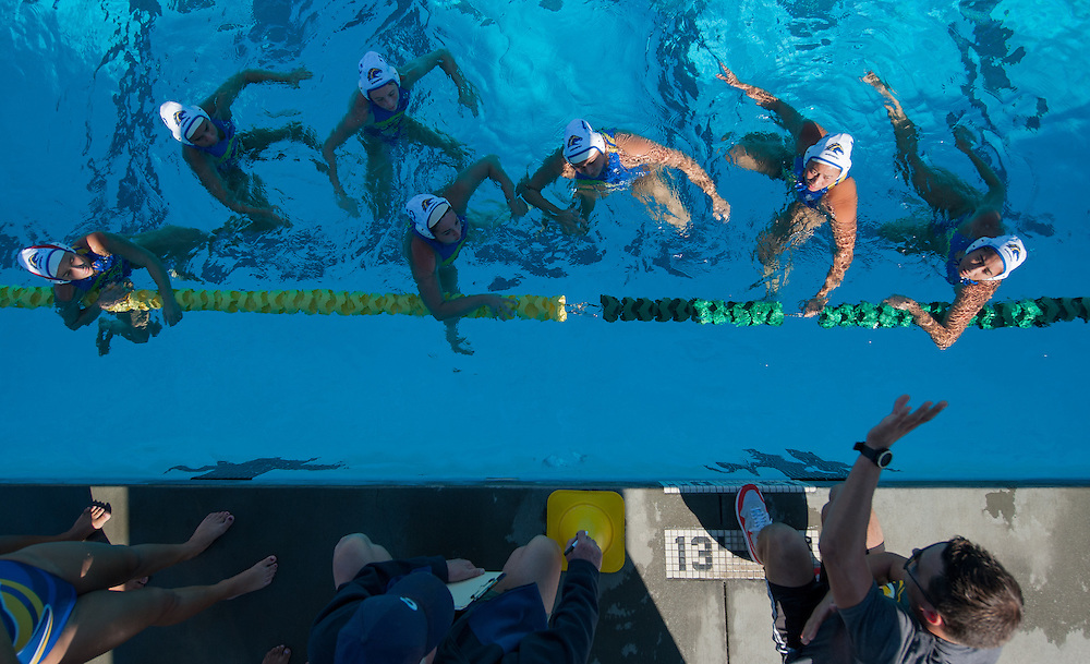 Mission Viejo, CA - Members of the Cypress College women's water polo team listen to their coaches during a time out during the Chargers  Orange Empire Conference water polo championships held at Saddleback College on November 3, 2016