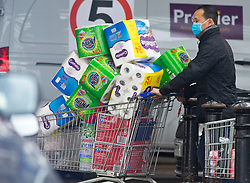 © Licensed to London News Pictures. 14/12/2020. <br /> Charlton, UK. A man leaving the store with a fully loaded trolley. Its starting to look a lot like stockpiling in Charlton, South East London at the local Makro and Booker superstore, people have been coming out all morning with shopping trolleys full of loo roll and kitchen roll. Photo credit:Grant Falvey/LNP