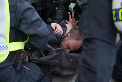 © Licensed to London News Pictures.03/04/2021. London, UK. 'Kill the Bill' protester is detained during the scuffles with police at Trafalgar Square, central London. The bill proposes new restrictions on protests during the Covid-19 coronavirus pandemic in England. Photo credit: Marcin Nowak/LNP