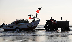 © Licensed to London News Pictures. <br /> 24/04/2015. <br /> <br /> Saltburn, United Kingdom<br /> <br /> Malcolm Jefferson launches his boat, Ellen, as he heads out to lay his lobster pots. Malcolm runs the last remaining commercial fishing boat out of Saltburn.<br /> <br /> <br /> Photo credit : Ian Forsyth/LNP