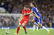 Adam Lallana of Liverpool is held by David Luiz of Chelsea. Premier league match, Chelsea v Liverpool at Stamford Bridge in London on Friday 16th September 2016.<br /> pic by John Patrick Fletcher, Andrew Orchard sports photography.