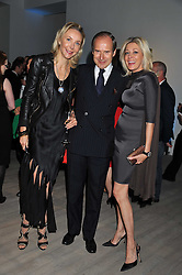 Left to right, SIMON & MICHAELA DE PURY and NADJA SWAROVSKI at Arts for Human Rights gala dinner in aid of The Bianca Jagger Human Rights Foundation in association with Swarovski held at Phillips de Pury & Company, Howick Place, London on 13th October 2011.