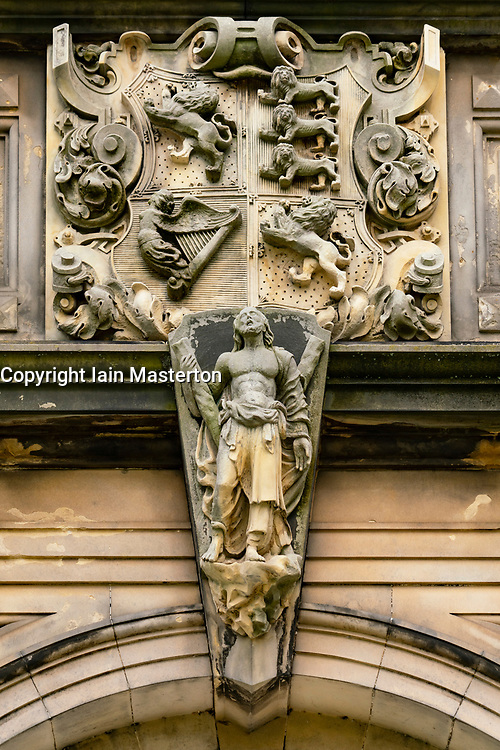 Detail of stone relief above door of lower and upper college halls in St Salvator's Quad, St Andrews University, Scotland, UK