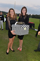 Left to right, ELLIE SANDCLIFFE and LADY LAURA CASH at the Chovgan Twilight Polo Gala in association with the PNN Group held at Ham Polo Club, Petersham Close, Richmond, Surrey on 10th September 2014.