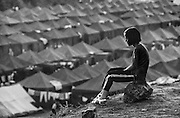 A child overlooks a refugee camp on the Macedonian/Kosovar border. Serbian military and paramilitary forces embarked on an ethnic cleansing campaign in Kosovo similar to the genocide they launched in Croatia and Bosnia.