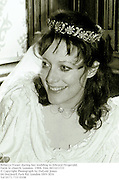 Rebecca Fraser during her wedding to Edward Fitzgerald. Farm St church. London. 1988. film 881031f33<br />
