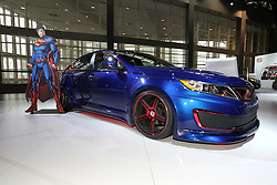08  February 2013: 2013 Kia Optima Hybrid dressed in Superman attire. Chicago Auto Show, Chicago Automobile Trade Association (CATA), McCormick Place, Chicago Illinois<br /> <br /> 2013 KIA Optima: Built in West Point, Georgia, the Kia Optima midsize sedan returns to the lineup in 2013 with head-turning design, fun-to drive performance, and technology. Every '13 Optima - available in LX, EX, SX and the all-new Limited trim -comes well equipped with a generous roster of standard feature. New this model year, is Remington Red exterior color replaces Spicy Red, and the SX Limited adds Nappa leather seating, exclusive 18-inch chrome wheels, red brake calipers, chrome exterior accents, wood interior accents, and LED daytime running lights. The 2013 Optima is offered with two fuel-efficient and powerful Theta II powerplants. This include a 2.4-liter GDI four-cylinder and a 2.0-liter GDI turbo engine. The 2.4-liter GDI engine produces 200 horsepower, while the 274 hp 2.0-liter turbo GDI engine delivers V-6-type power with a four-cylinder's efficiency. Each engine choice comes mated the standard six-speed automatic transmission featuring Sportmatic clutchless shifting. A 2.4-liter hybrid powertrain is also available. Optima's five-passenger cabin provides the experience of a performance vehicle without sacrificing comfort or roominess. A sport-inspired Sportmatic shifter delivers crisp shifts while an available panoramic sunroof provides an open-air feeling. The Technology Package (requires Premium Touring Package) features the navigation system with back-up camera and SiriusXM Traffic.