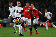 Alexis Sanchez of Manchester United (R) gets to the ball ahead of Christian Eriksen of Tottingham Hotspur.  Premier league match, Tottenham Hotspur v Manchester Utd at Wembley Stadium in London on Wednesday 31st January 2018.<br /> pic by Steffan Bowen, Andrew Orchard sports photography.