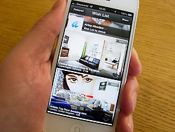 detail of iPhone 5 with Airbnb travel accommodation app for booking rooms