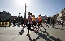 Competitors pass through Trafalgar Square during the 2019 London Landmarks Half Marathon.