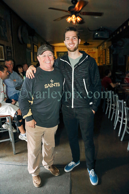 23 November 2015. Finn McCool's Irish Pub, New Orleans, Louisiana.<br /> Major League Soccer (MLS) star player Patrick Mullins of New York City FC poses for a photo with his former Jesuit high school soccer coach Hubie Collins.<br /> Photo©; Charlie Varley/varleypix.com