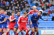 Tareiq Holmes-Dennis of Oldham Athletic tries to flick on a corner during the Sky Bet League 1 match between Oldham Athletic and Chesterfield at Boundary Park, Oldham, England on 28 March 2016. Photo by Simon Brady.