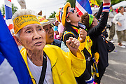 07 AUGUST 2013 - BANGKOK, THAILAND: Thai anti-government Yellow Shirts cheer during a protest against a proposed amnesty bill. About 2,500 protestors opposed to an amnesty bill proposed by Thailand's ruling party marched towards the Thai parliament in the morning. The amnesty could allow exiled fugitive former Prime Minister Thaksin Shinawatra to return to Thailand. Thaksin's supporters are in favor of the bill but Thai Yellow Shirts and government opponents are against the bill. Thai police deployed about more than 10,000 riot police and closed roads around the parliament. Although protest leaders called off the protest rather than confront police, a few people were arrested for assaulting police when they tried to break through police lines. Several police officers left the scene under medical care after they collapsed in the heat.    PHOTO BY JACK KURTZ