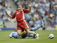 Photo: Aidan Ellis.<br /> Manchester City v Portsmouth. The Barclays Premiership.<br /> 27/08/2005.<br /> Pompys Gregory Vignal is tackled by Manchester's Trevor Sinclair