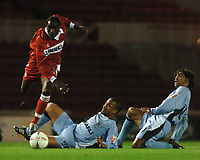 Photo: Back Page Images. 27/10/2004.<br /> Carling Cup. Middlesbrough v Coventry City. The Riverside Stadium.<br /> Joseph Desire-Job skips past both Richard Shaw (right) and Eric Deloumeaux