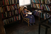 Image of a young girl reading at Bart's Books in Ojai, California, America West by Randy Wells