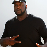 Coke Zero 400 Grand Marshal and former NBA player Shaquille O'Neal is seen in the media area, prior to the NASCAR Coke Zero 400 Sprint series auto race at the Daytona International Speedway on Saturday, July 6, 2013 in Daytona Beach, Florida. Actor Kevin James and Adam Sandler are the other Marshals.  (AP Photo/Alex Menendez)