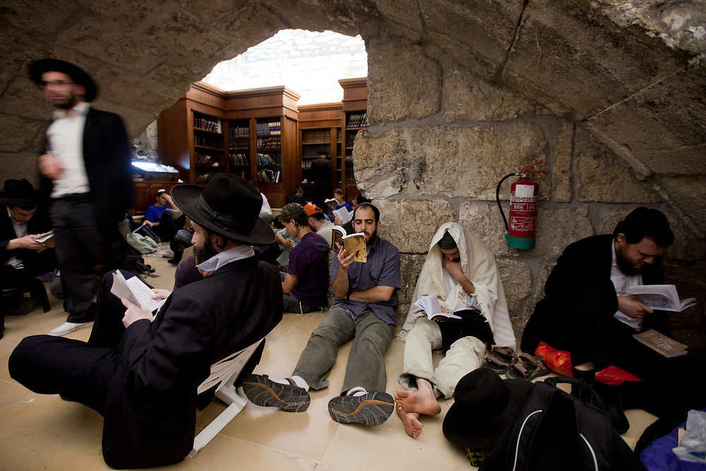 Religious Jews pray at the Western Wall, Judaism's holiest site, in Jerusalem's Old City, during the Jewish holy day of Tisha B'Av, July 20, 2010.  Tisha B'Av (9th of Av), a day of fasting and lament, is when Jews mourn the destruction of the biblical temples.