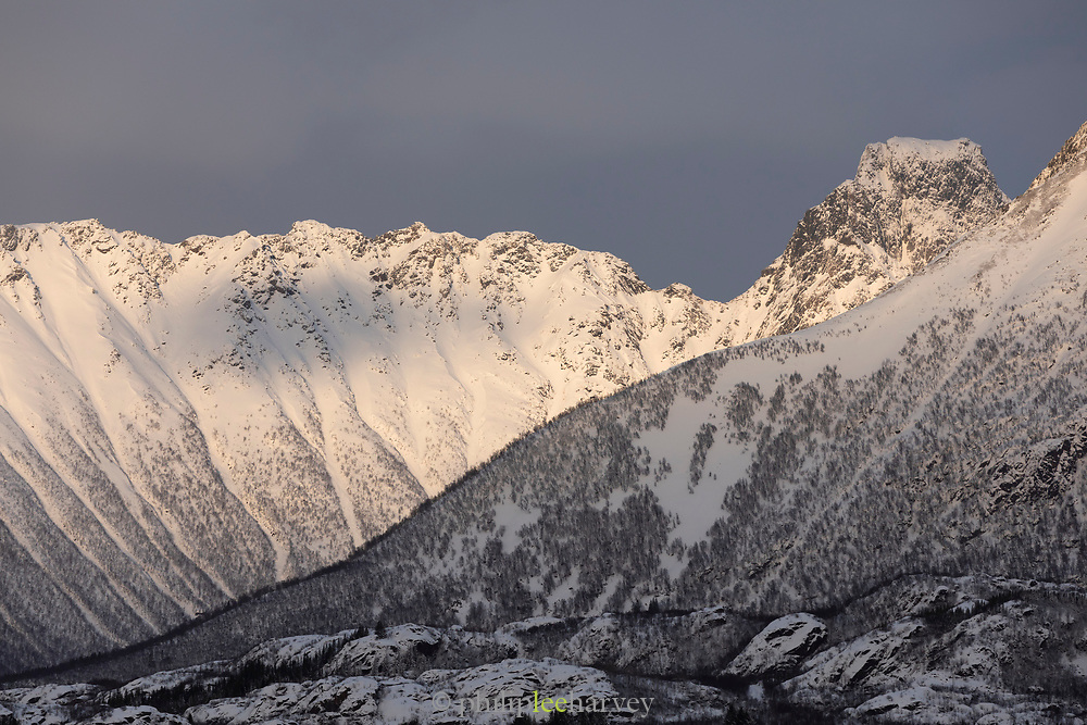 Trollfjord covered in snow against cloudy sky, Lofoten archipelago, Norway