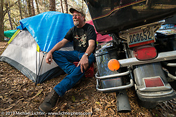 Camping out by the Cabbage Patch gave Charlie Anderson of Spokane, WA a chance to do some maintenance on his bike before the return ride of 4,600 miles to Washington state. Daytona Bike Week. FL, USA. March 12, 2014.  Photography ©2014 Michael Lichter.