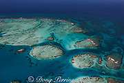 aerial view of southern Belize barrier reef in vicinity of Placencia, showing reef bend at Gladden Spit, in Gladden Spit and Silk Cayes Marine Reserve, with two tour boats inside the reef, and three fishing boats outside the reef, Belize, Central America ( Caribbean Sea )