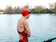 A member of the Serpentine Swimming Club after swimming in the Serpentine Lake on a cold Winter day, Hyde Park, London, UK. The Serpentine Lake is situated in Hyde Park, London's largest central open space. The Serpentine Swimming Club was formed in 1864 'to promote the healthful habit of bathing in open water throughout the year'.  Its headquarters were beneath an old elm tree on the south side of the lake, a wooden bench for clothing being the only facility.  At this time London was undergoing rapid expansion and Hyde Park was now in the centre of a densely populated built up area and provided a place of relaxation to its urbanised masses. Now, the club has its own (somewhat spartan) changing facilities and members are  permitted by the Royal Parks to swim in the lake any morning before 09:30.  They race every Saturday morning throughout the year, regardless of the weather.