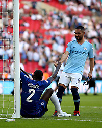 Cheslea's Antonio Rudiger is lifted up by Manchester City'Äôs Ilkay Gundogan at full time