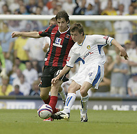 Photo: Aidan Ellis.<br /> Leeds United v Hartlepool United. Coca Cola League 1. 08/09/2007.<br /> Leeds Jonny Howson is challenged by Hartlepool's James Brown