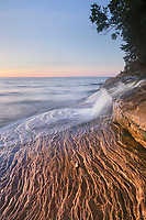 Elliot Falls flowing over layers of Au Train Formation sandstone at Miners Beach. Pictured Rocks National Lakeshore Michigan
