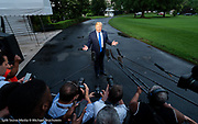 President Donald Trump stopped to speak with the press as he leaves the White House in Washington, DC via Marine One on the South Lawn on the evening of June 2, 2019.