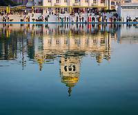 NEW DELHI, INDIA - CIRCA NOVEMBER 2018: Reflection of the Gurudwara Bangla Sahi also known as Sikh house of worship in Delhi. This is oone of the most prominent Sikh gurdwara, often recognized by the pool inside its complex and the golden dome.
