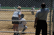 View of a baseball game through a fence