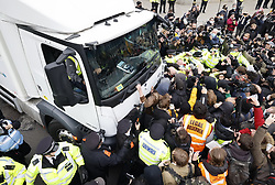 © Licensed to London News Pictures. 03/04/2021. London, UK. Scuffles have broken out as protesters surrounded a McDonald's truck in Parliament Square in central London during a 'Kill the Bill' demonstration and rally. A coalition of groups including Extinction Rebellion, Kill the Bill & Black Lives Matter are coming together over the Easter weekend to campaign against the proposed Police, Crime, Sentencing and Courts Bill which will give police in England and Wales more power to impose conditions on non-violent protests. Photo credit: Peter Macdiarmid/LNP