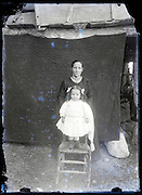 eroding glass plate photo of mother with dressed up little child