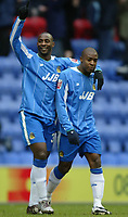 Photo: Chris Brunskill. Wigan Athletic v Leeds United.. Coca-Cola Championship. 19/02/2005. Jason Roberts(L) congratulates his strike partner Nathan Ellington(R) after he had scored the opening goal of the game for Wigan.