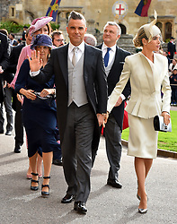 Robbie Williams and Ayda Field arrive for the wedding of Princess Eugenie to Jack Brooksbank at St George's Chapel in Windsor Castle.