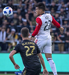 May 26, 2018 - Los Angeles, California, U.S - DC United's Yamil Asad (22) goes up for the ball against LAFC's Tristan Blackmon (27) during the first half of the match between Los Angeles Football Club and DC United at the Banc of California Stadium on Saturday, May 26, 2018. (Credit Image: © Michael Goulding via ZUMA Wire)