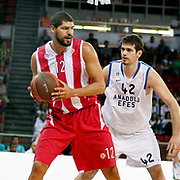Anadolu Efes's Stanko BARAC (R) and Olympiacos's Lazaros PAPADOPOULOS (L) during their Two Nations Cup basketball match Anadolu Efes between Olympiacos at Abdi Ipekci Arena in Istanbul Turkey on Sunday 02 October 2011. Photo by TURKPIX
