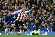 Ryan Woods of Brentford (L) is challenged by Ruben Loftus-Cheek of Chelsea (R). The Emirates FA Cup 4th round match, Chelsea v Brentford at Stamford Bridge in London on Saturday 28th January 2017.<br /> pic by Steffan Bowen, Andrew Orchard sports photography.