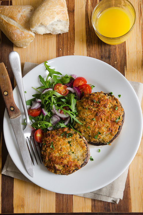 Cheese stuffed mushrooms with rocket and tomato salad