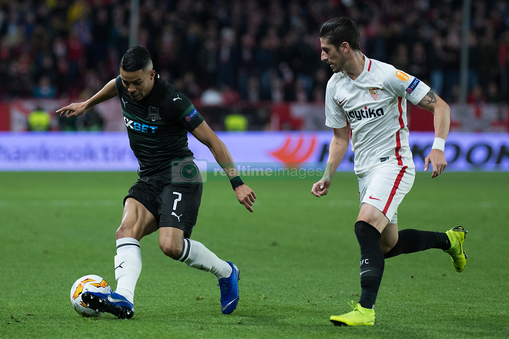 December 13, 2018 - Seville, Andalucia, Spain - Sergio Escudero of Sevilla FC and Wanderson of Krasnodar fight for the ball during the Europa League match between Sevilla FC and Krasnodar in Ramón Sánchez Pizjuán Stadium (Seville) (Credit Image: © Javier MontañO/Pacific Press via ZUMA Wire)