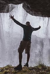 THEMENBILD - ein Mann steht auf einem Weg hinter dem Wasserfall waehrend einer Wanderung entlang des Wasserfallweges, aufgenommen am 28. Juli 2019 in Fusch a. d. Grossglocknerstrasse, Oesterreich // a Men stands on a trail behind the waterfall while hiking along the waterfall trail in Fusch a. d. Grossglocknerstrasse, Austria on 2019/07/28. EXPA Pictures © 2019, PhotoCredit: EXPA/ Stefanie Oberhauser