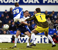 Photo: Chris Ratcliffe.<br />Ipswich Town v Portsmouth. The FA Cup. 07/01/2006.<br />Andy O'Brien (C) tussles with Ipswich player Danny Haynes as Sander Westerveld in goal watches on.