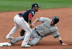 October 6, 2017 - Cleveland, OH, USA - Cleveland Indians second baseman Jose Ramirez, left, tags out the New York Yankees' Todd Frazier as he attempts to steal second in the second inning during Game 2 of the American League Division Series, Friday, Oct. 6, 2017, at Progressive Field in Cleveland. (Credit Image: © Mike Cardew/TNS via ZUMA Wire)