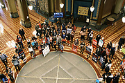 "11 JANUARY 2021 - DES MOINES, IOWA: People gather in the Rotunda of the Iowa State Capitol in Des Moines. Hundreds of Iowans from across the state came to the State Capitol to protest the Governor's COVID-19 mitigation efforts. The Coronavirus (SARS-CoV-2) mitigation guidelines include a mask mandate indoors when it isn't possible to social distance. But the Governor specifically exempted the State Capitol. No one in the crowd wore a mask and there was no effort to follow ""social distancing"" guidelines. There were also ""anti-Vaxxers"" in the crowd who protested the vaccine efforts and said vaccines were unsafe.           PHOTO BY JACK KURTZ"